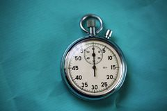 Old stopwatch isolated on wooden background Royalty Free Stock Photography