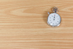 Old stopwatch on wooden table Royalty Free Stock Photos