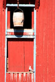 Old storage house. Detail of an old storage house with a bright red wooden wall and a seagull Royalty Free Stock Images