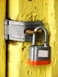 Old Storage Locker. Bright yellow old storage locker; unlocked padlock royalty free stock photography