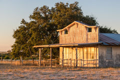 Old Store Front Texas Hill Country. 1800`s rustic building with a Texas sunrise warm glow Royalty Free Stock Photos