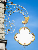 Old store sign. Beautiful old store sign with space for text in front of blue sky (herderstrasse - vienna Stock Images