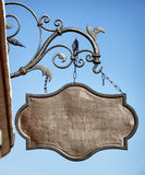 Old store sign. Beautiful old store sign in front of sky Royalty Free Stock Photos