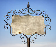 Old store sign. Beautiful old store sign in front of sky Royalty Free Stock Images