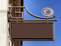 Old store sign. Beautiful old store sign in front of sky Royalty Free Stock Photo
