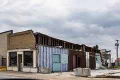 Free Old Storefront In American Small Town Showing Walls Where Another Building Has Been Demolished With Interior Walls Visible - Very Stock Images - 138781374