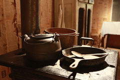 Old stove with pots and pans stock photography