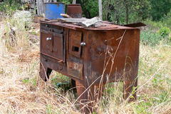 Old stove. Rejected the old stove in a field exposed to the influence of time Royalty Free Stock Image