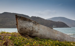 Old stranded boat outside Santa Marta, Colombia. The boat must have been there for many years. Picture takes as the sun started to set Stock Photography