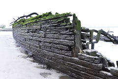 Old, stranded shipwreck on the beach Stock Image