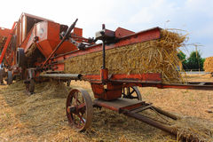 Old straw baler royalty free stock photography