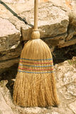 Old straw broom Stock Image