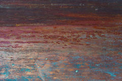 Old, streaked, painted and weathered metal background. With blue and red highlights Stock Images