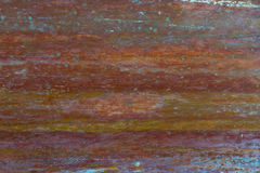 Old, streaked, painted and weathered metal background. With blue and red highlights Stock Photography