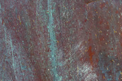 Old, streaked, painted and weathered metal background. Texture Royalty Free Stock Photo