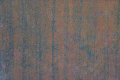 Old, streaked, painted and weathered metal background. Texture Stock Image
