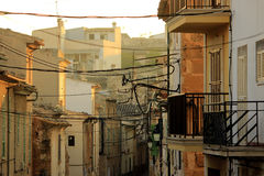 Old street in Alcudia, Mallorca, Spain. Sunrise in Alcudia. Old street with houses and wires Royalty Free Stock Photography