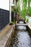 Idyllic old street green trees river stream, Hida Furukawa, Japan royalty free stock photography