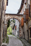 Old Street with Arch in the Ancient Italian Walled City of Soave. Royalty Free Stock Photo