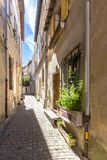 Old street in Arles, France. Typical street with old houses in Arles, Provence, France Royalty Free Stock Image