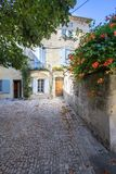 Old street in Arles, France. Typical street with old houses in Arles, Provence, France Royalty Free Stock Images