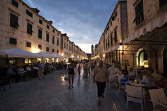 Old street and cafes at night in Dubrovnik Royalty Free Stock Images
