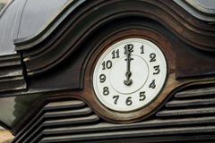 Old street clock, metal ornaments. The afternoon. Royalty Free Stock Images