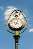 Old street clock. Old street clock, metal ornaments. Indicates an hour in the afternoon Stock Photo