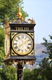Old street clock in Tbilisi stock images