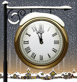 Old street clock. Vintage street clock hanging on forged brackets against the winter old city. New Year sign. There is in addition a vector format (EPS 10) with Stock Image