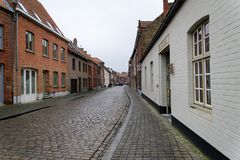 Old street with cobblestones in Ghent without people walking stock photos