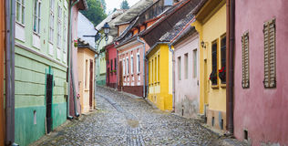 Old street with colorful houses in Sighisoara Stock Photos