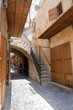 Old street in downtow Saida, Lebanon. Old street with sandstone arc and wooden closed doors in downtown of Saida, Lebanon Royalty Free Stock Photo