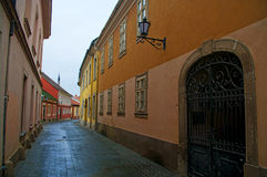 Old street in Eger, Hungary. Old street detail in the medieval town of Eger, Hungary Stock Photo