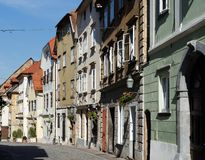 Old street in European town converging in perspective Royalty Free Stock Photos