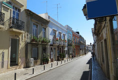 Old street (Faro, Portugal). View of the 2-storey buildings on the old street (Faro, Portugal Stock Image