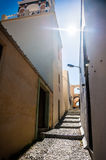 Old street in Fira town at sunset. Royalty Free Stock Photography