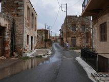 Old street in Greece. Old village street in Greece after heavy rain Stock Image