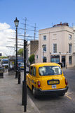 Old street Greenwich view with yellow taxi Stock Photography