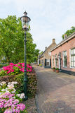 Old street with historic houses in a Dutch village Stock Image
