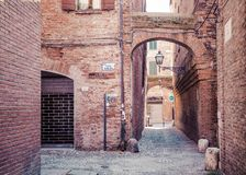 Old street in historical center of Ferrara, Italy Stock Photo