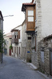 Old street and house in Alacati, Stock Photo
