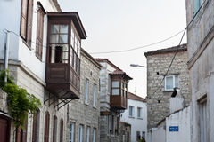 Old street and house in Alacati, Izmir, Turkey Stock Image