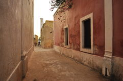 Old street with houses on island of mozambique. Ilha de mocambique, traditional architecture Royalty Free Stock Image