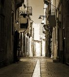 Old Street and Houses in Malta. An old narrow road in Birgu, Malta in sepia tone Royalty Free Stock Photography