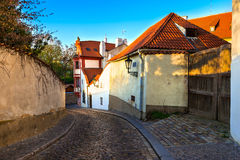 Old street of Hradcany in Prague at sunset Stock Image