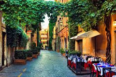Free Old Street In Rome With Leafy Vines And Cafe Tables, Italy Stock Photography - 147548222