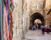 Old street in Jerusalem. Street in old part of Jerusalem with group of Arabian children walking home from school Royalty Free Stock Image