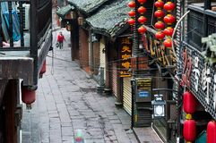Old street with karaoke bars, Fenghuang, China. FENGHUANG, CHINA - NOV 12, 2014 - Old street with karaoke bars, Fenghuang, China royalty free stock photography