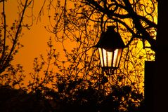 Halloween street lamp. An old street lamp at goldenhour in the historic city of Sighisoara, Transylvania Royalty Free Stock Image